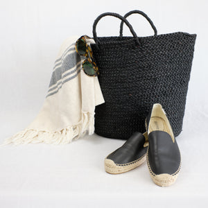 black raffia beach tote and turkish beach towel
