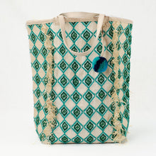 Load image into Gallery viewer, Jade and green beach tote embroidered with a diamond pattern. Natural leather handle and charm with green and blue pom pom.