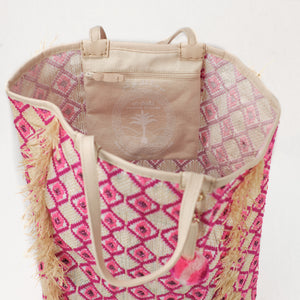 Interior view of beach bag made from recycled grain bags. Interior features a zip pocket and leather trim.