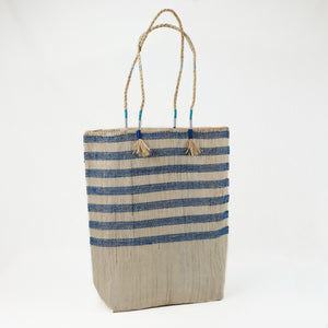Blue and natural stripe tote bag made from recycled grain bags in Morocco.