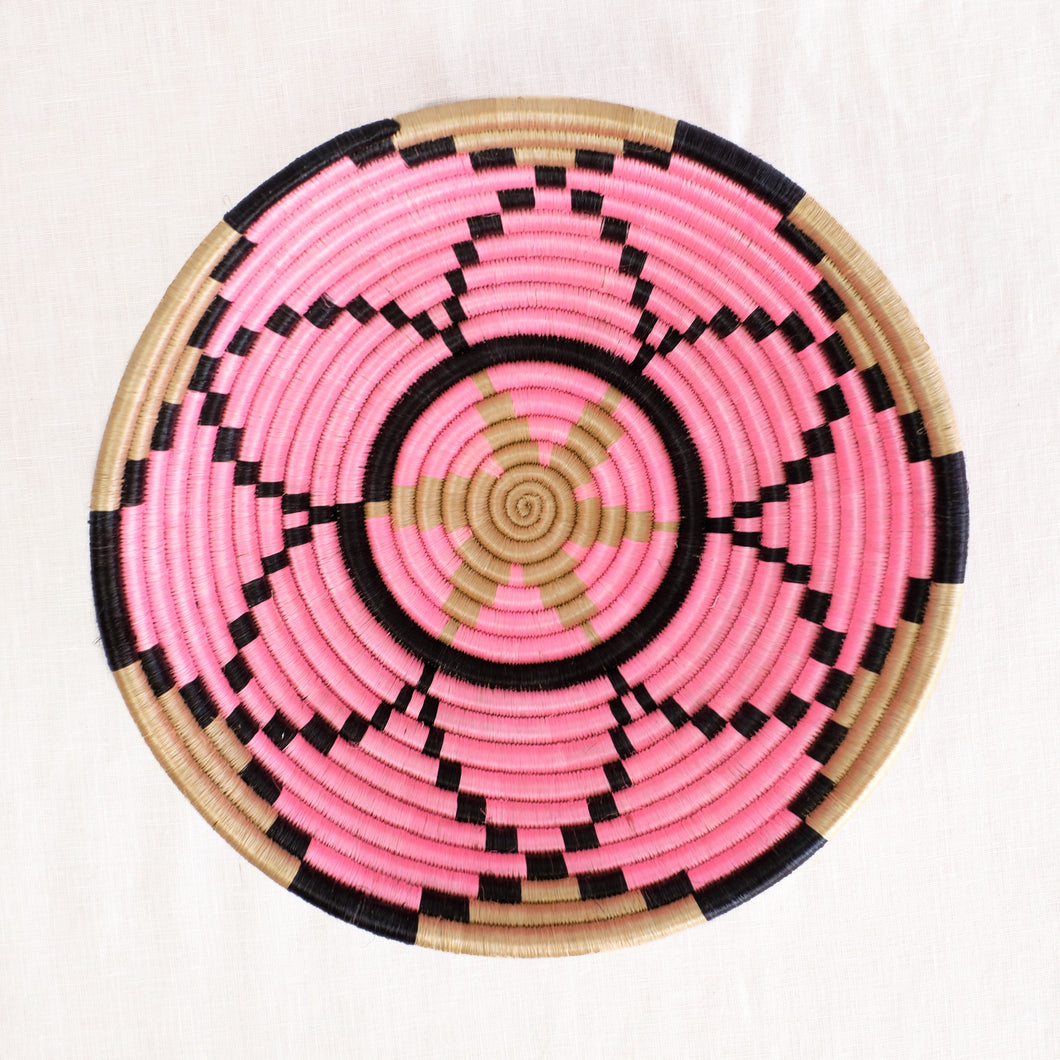 Artisan plateau basket with pink and black flower pattern by Indego Africa
