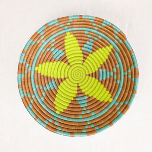 Artisan basket with yellow and aqua star pattern by Indego Africa