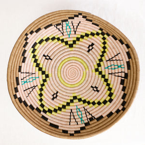 African plateau basket with natural, pink, aqua and yellow design