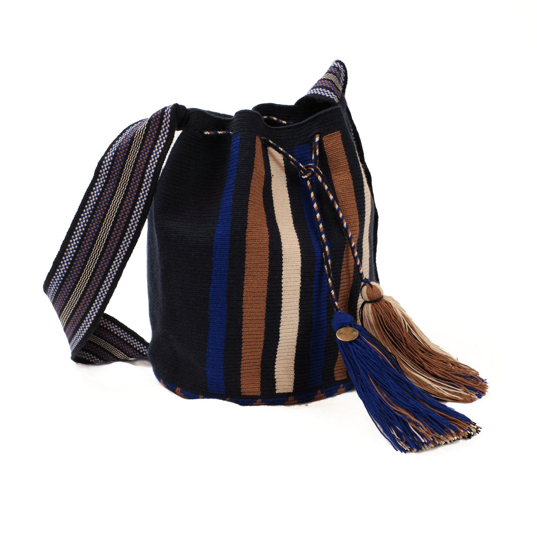 Soft woven bucket bag in navy, cobalt blue, sepia and white. Wide cross body strap and drawstring closure finished with handmade tassels in navy, cobalt, sepia and white.