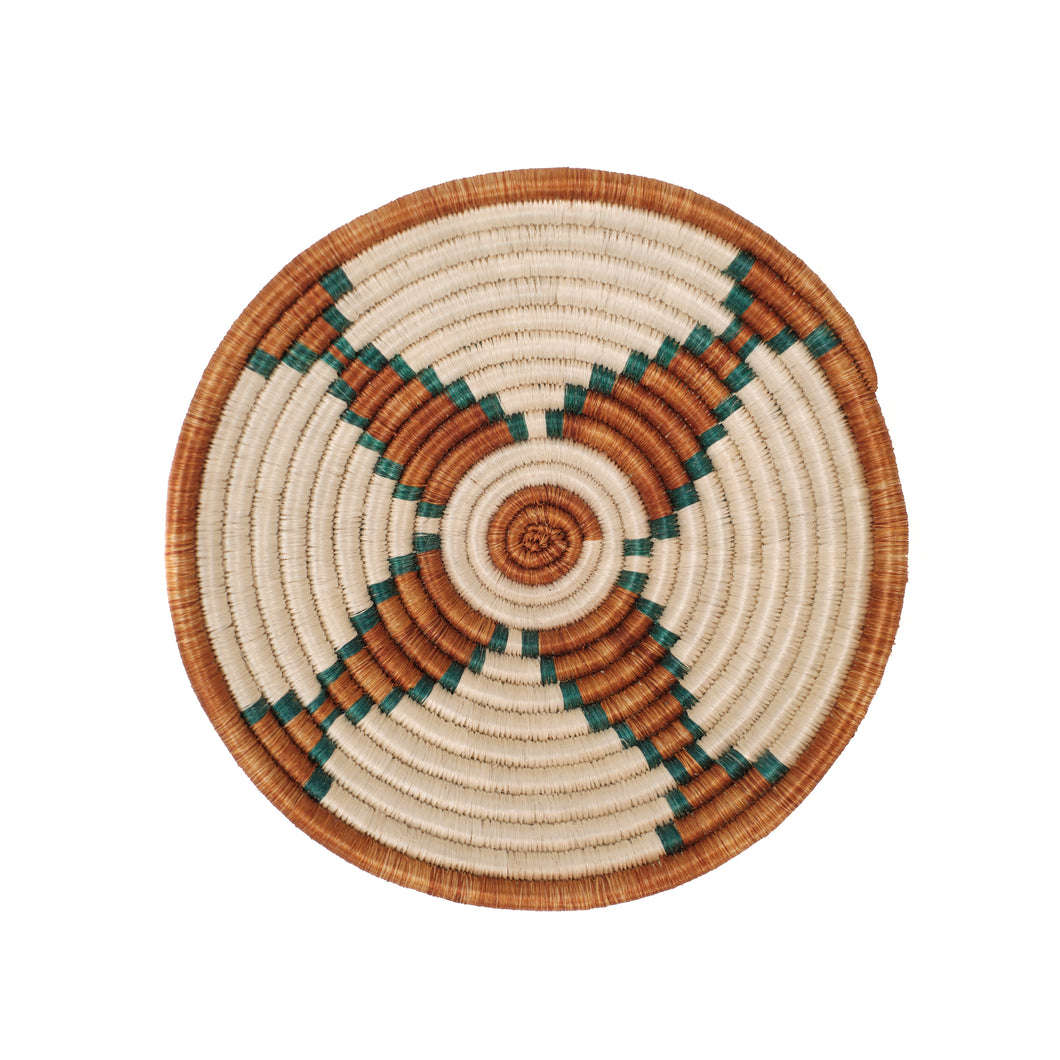 Small basket woven into a bowl shape. Natural, sepia and teal dyed grasses creat a graphic star pattern.