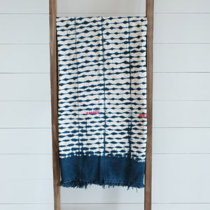 Indigo and white cotton blanket dyed with shibori technique. Wide indigo border with colorful hand stitched blocks. Vintage piece, imperfections are part of its nature.