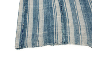 Indigo and cream striped cotton blanket. Vintage piece from Africa shows hand mending, hand rolled hem and rustic stitch work.