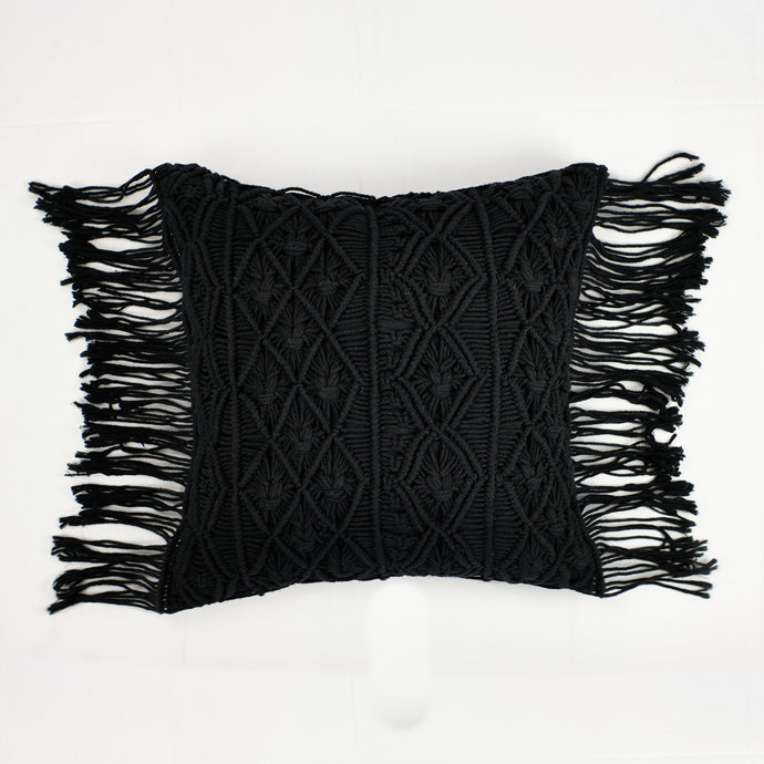 Black crochet pillow with fringe trim