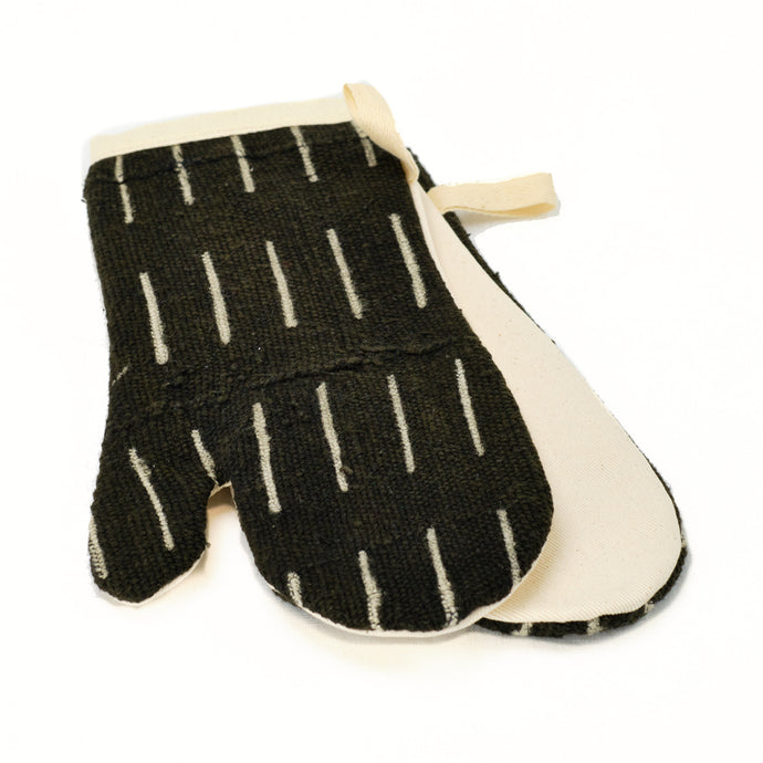 pair of oven mitts in black and natural mud cloth