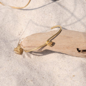 gold plated bracelet on beach