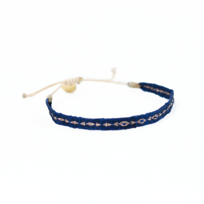 Deep Azure blue woven friendship bracelet with gold thread and azure glass beads. Adjustable cord to fit multiple wrist sizes.