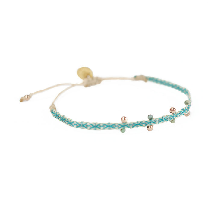 Aqua-Green woven friendship bracelet embellished with jade and gold plated beads. Adjustable waxed cord closure.