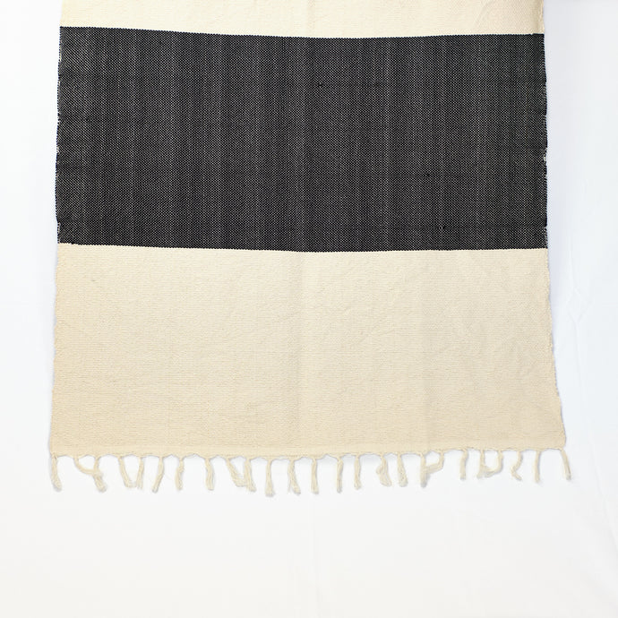 cotton throw in cream with bold black stripe and natural fringe finish