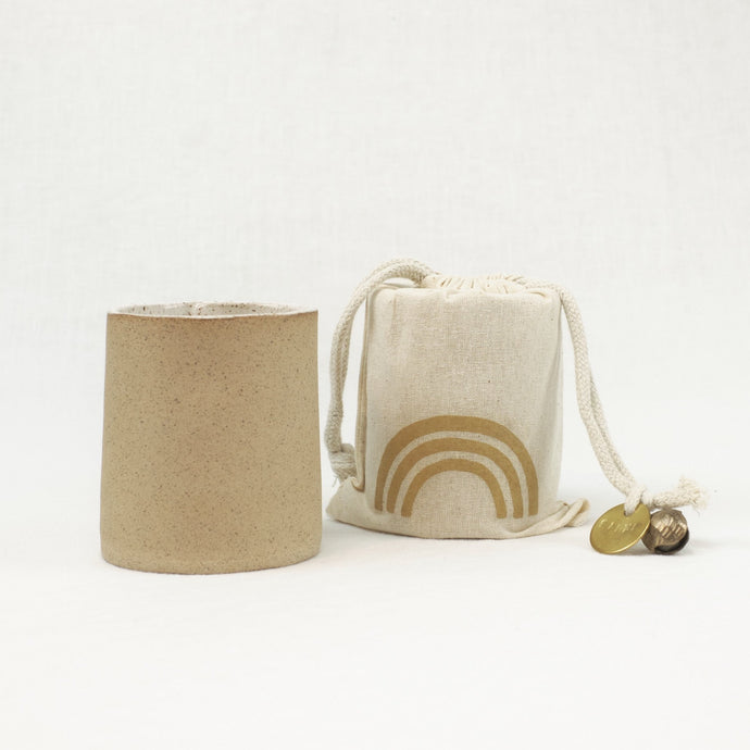 Earth scented soy candle in unglazed ceramic vessel. Comes in a muslin gift bag.