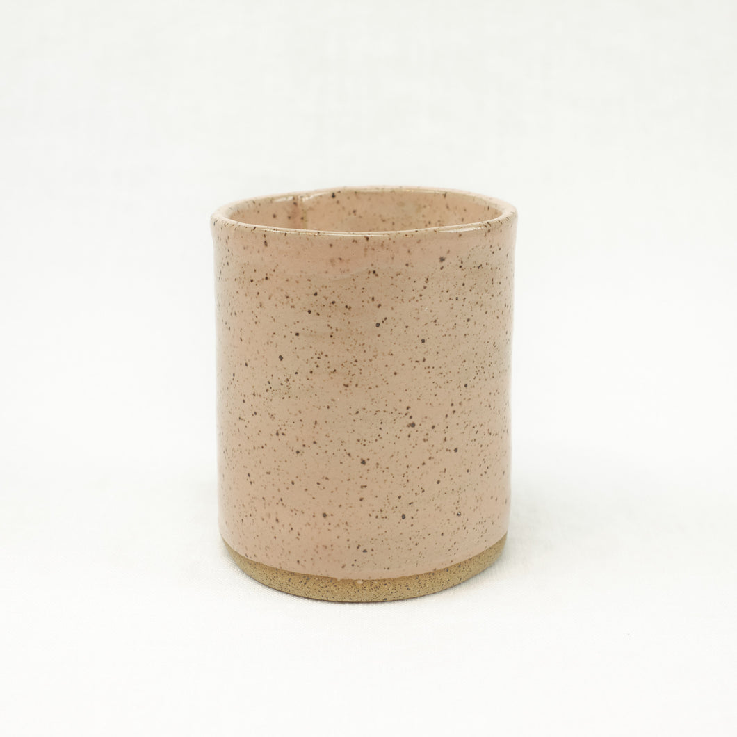 Cedar scented soy candle in a blush pink ceramic vessel. Made by Catherine Rising.