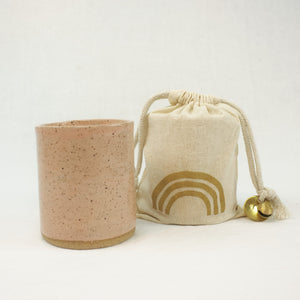Cedar scented soy candle in a blush ceramic vessel by Catherine Rising. Comes wrapped in  a muslin bag.