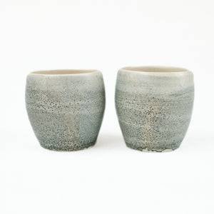 Two small blue-grey ceramic cups by Totem Home.