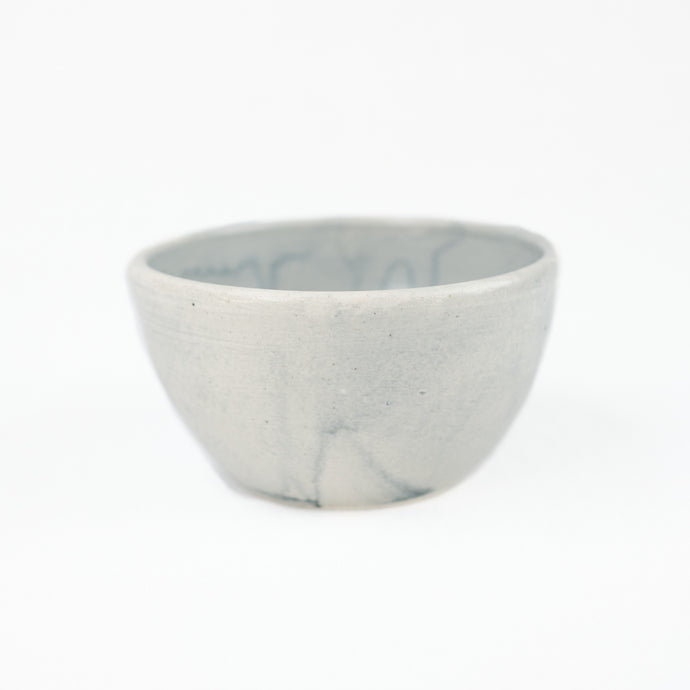 Blue-grey ceramic bowl by Totem Home.