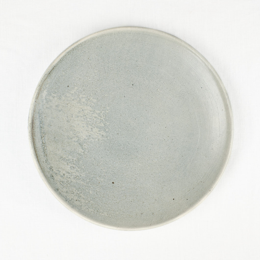 Blue-grey ceramic dinner plate by Totem Home.