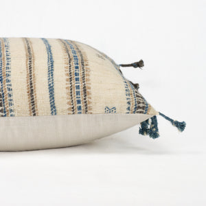 Artisan pillow in cream wool with blue, tan and brown blanket fringe trim