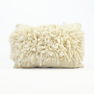 Natural wool pillow with natural yarn tufts by Treko Wool.