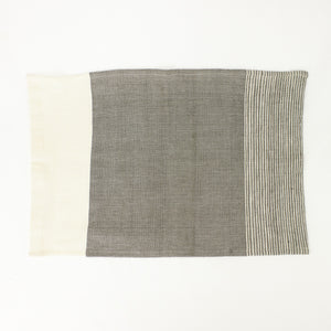 Handwoven tea towel with natural and grey color blocking and stripes