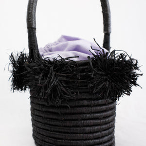 Mini basket bag with raffia pom poms in black