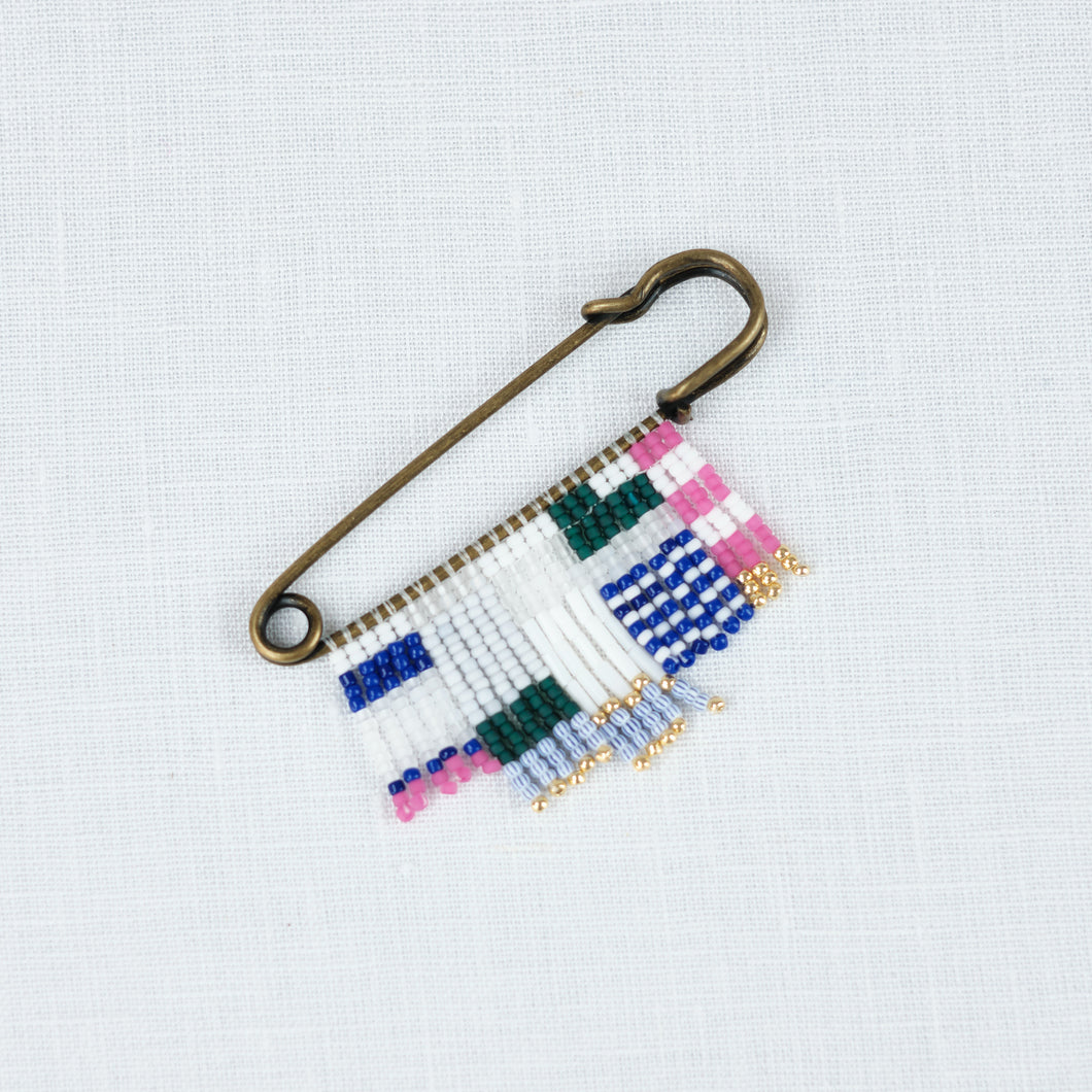 Brass Pin with blue, white, green & bright pink bead. A graphic friendship pin by Alice Rise.