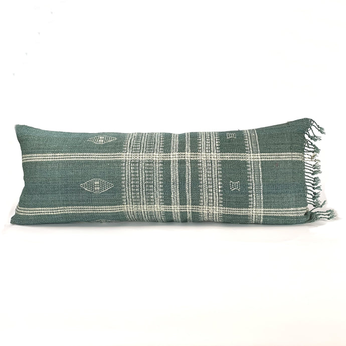 long lumbar pillow in sage green and cream rustic wool textile with fringe trim