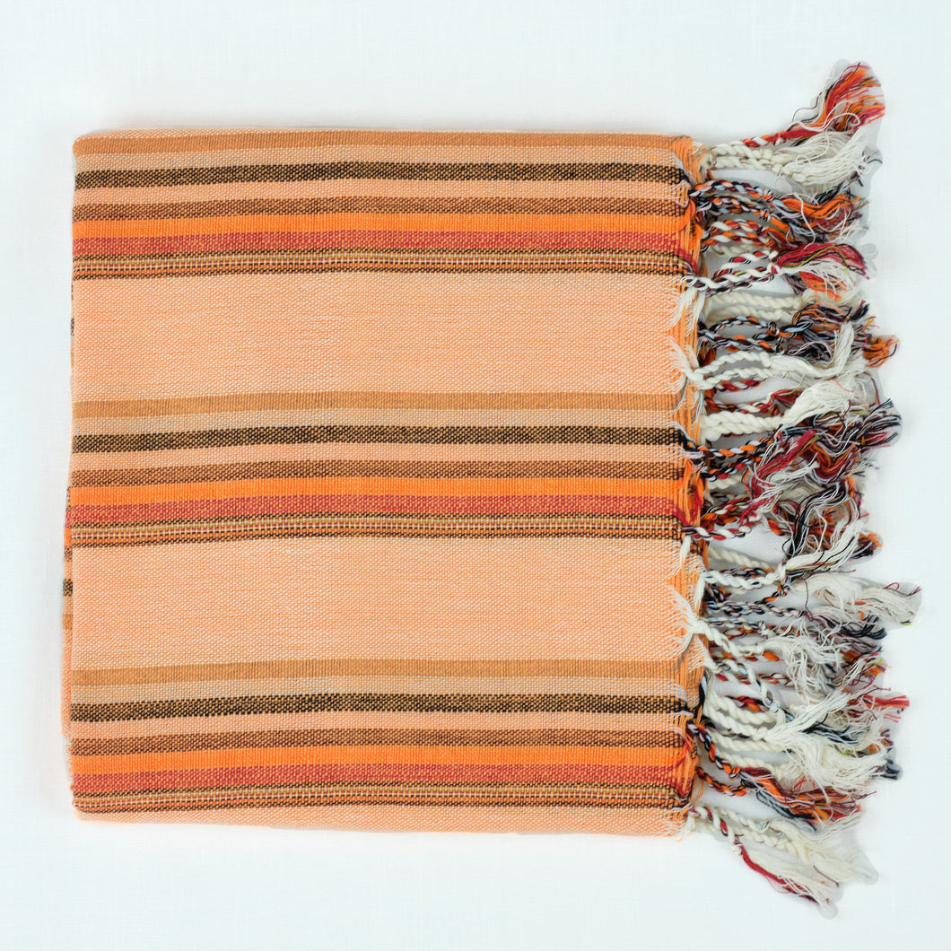 orange and rust striped cotton Turkish towel with fringe