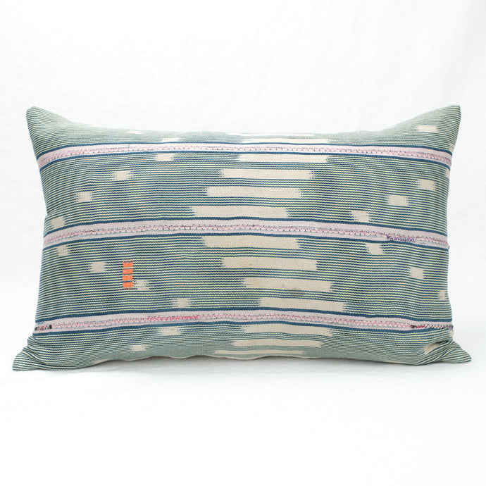 Faded indigo and stripe baule pillow. Vintage textile front with hand mending, solid linen back.