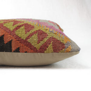 Side view of rustic kilim pillow, back side in khaki cotton twill.