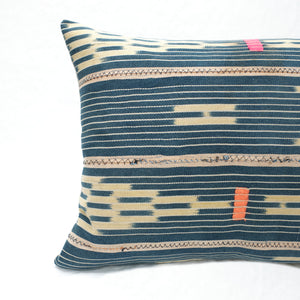 Close up of Indigo Baule Pillow made from vintage fabric showing zig zag stitching and hand mending.