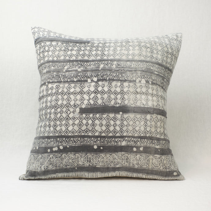 The Mila Hmong Pillow in a grey and white batik pattern. 24