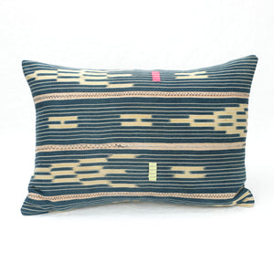 Indigo Baule Pillow with neon pink and lime green decorative stitching. Small rectangular shape.