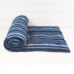Tensira cotton bedroll in an indigo tie dye stripe.
