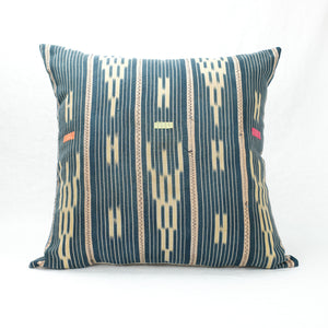 "Indigo Baule Pillow 22"" x 22"" tea stained for a soft natural look. Pattern has soft pink stripes and day-glo decorative stitching."