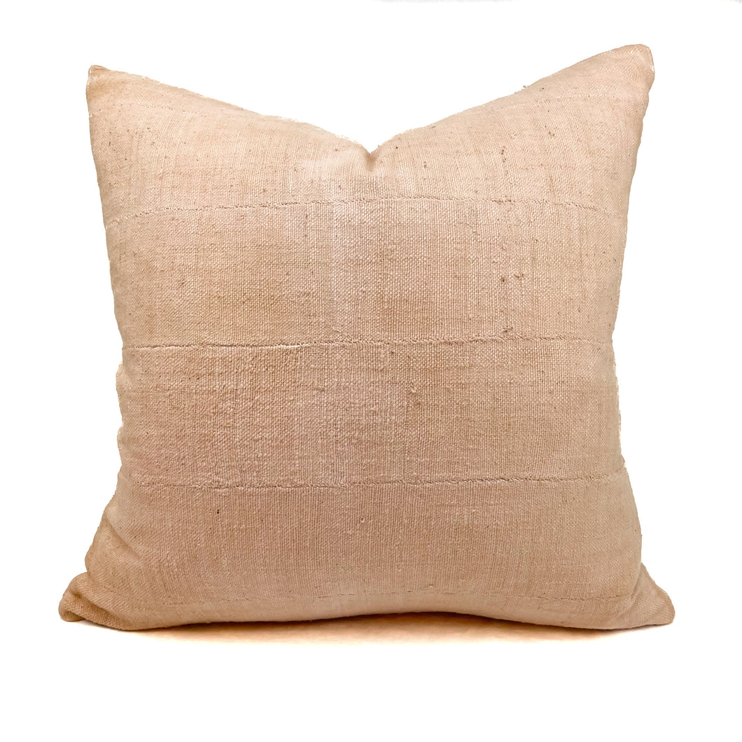 Mudcloth boho pillow hand dyed in blush pink from natural dyes. Measures 20
