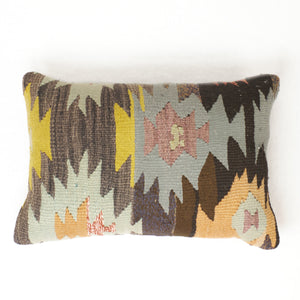 Vintage kilim pillow with abstract design in brown, plum, gold, pumpkin and mint.  Tan cotton twill back.