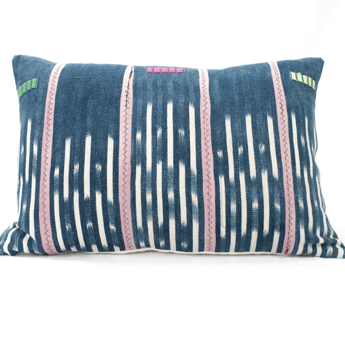 Indigo Baule Pillow with pink stripes and white pattern.