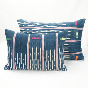Large and small indigo Baule pillows shown together.