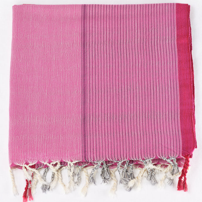 Turkish towel in bright pink with fuchsia stripes and fringe trim