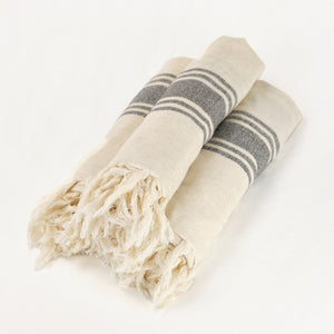 hand loomed linen towel in ecru with black stripes and fringe trim