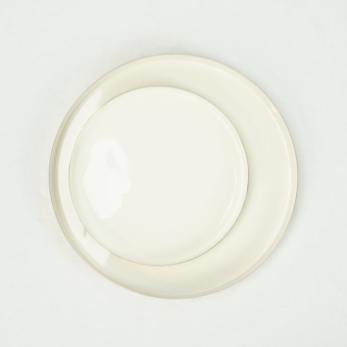 Louise Brass and white enamel trays. Two shown, circular shape, size small and medium. Made by Hawkins NY.