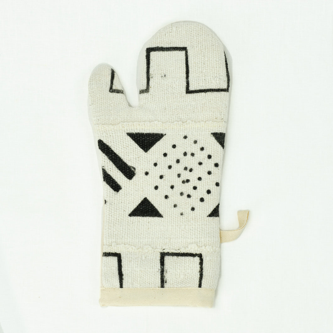 white and black oven mitt in African mud cloth