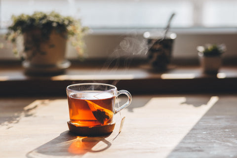 Hot tea brewing in the morning sun - keto drink alternatives