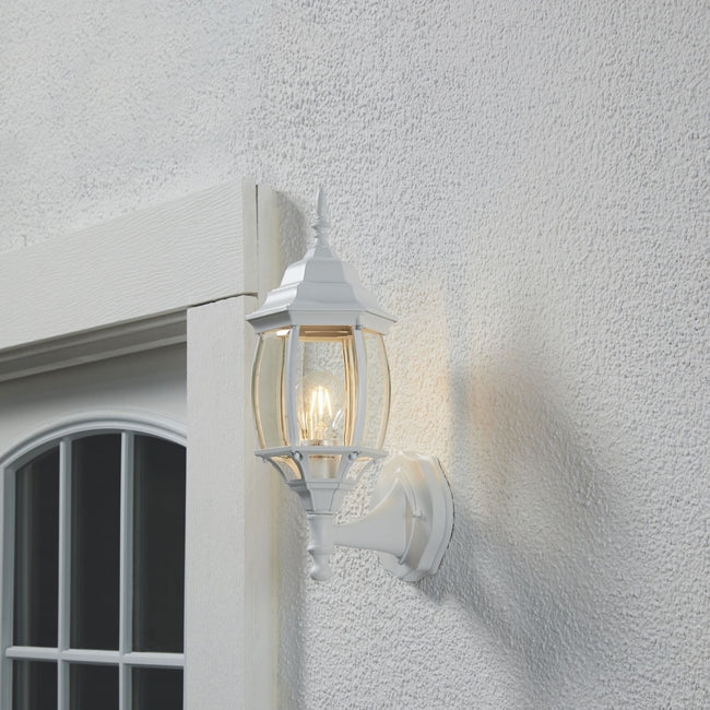 Nobela Outdoor Wall Lantern / Sconce Waterproof Up-Facing Light - White on a stucco wall with its light turned on.