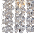 Close up for Cora track light pendant crystals - illuminated light bulb