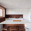 Brown and Tan Kitchen/Living space with the Summerhill Track Lighting Kit hanging above