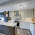 White, grey and Brown Kitchen/Living space with the Madrid Track Lighting Kit hanging above